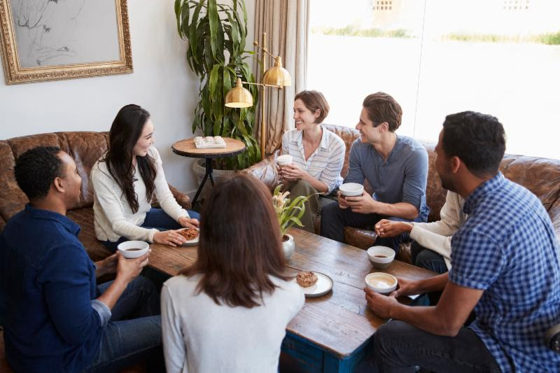 a group of people drinking coffee